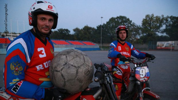 MOSCOW - Vladimir Sosnitsky (left), Captain of the Russian Motoball team, poses with one of his team mates  (National Geographic/Olly Bootle)